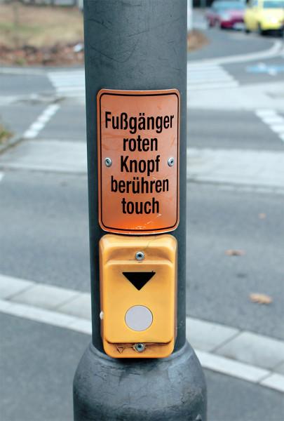 Fußgänger roten Knopf berühren touch
