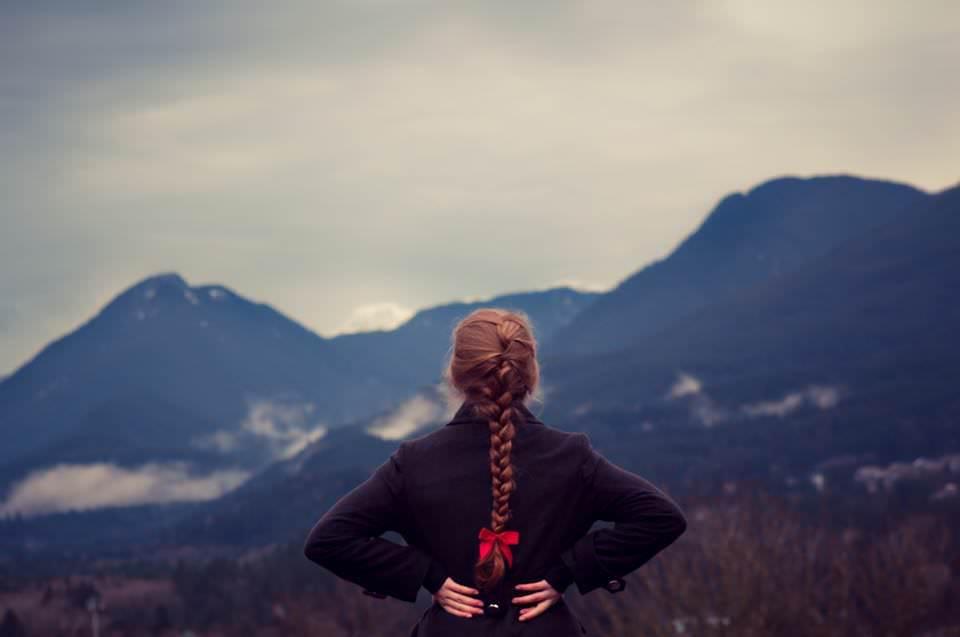 Girl Staring at Mountains
